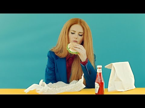 "Lena Katina recreates ""Andy Warhol Eating burger"" scene in the new video ""Mcdonalds""."
